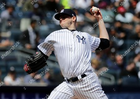 New York Yankees' Jordan Montgomery delivers a pitch during the third inning of a baseball game against the Minnesota Twins, in New York