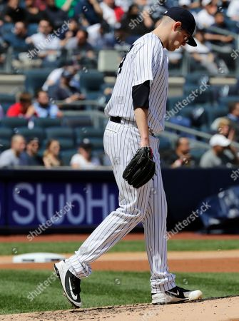 New York Yankees starting pitcher Jordan Montgomery reacts after Minnesota Twins' Eduardo Escobar hit a two-run home run during the third inning of a baseball game, in New York