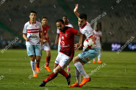 Al-Zamalek player Mahmoud Hamdy (r) fights for the ball with Al-Ahly player wLID soliman (l) during the Egyptian Premier League soccer match between Al-Ahly and Al-Zamalek at International Cairo Stadium in Cairo, Egypt, 26 April 2018.