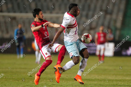 Al-Zamalek player Kabongo Kasongo (r) fights for the ball with Al-Ahly Ayman Ashraf  (l) during the Egyptian Premier League soccer match between Al-Ahly and Al-Zamalek at International Cairo Stadium in Cairo, Egypt, 26 April 2018.