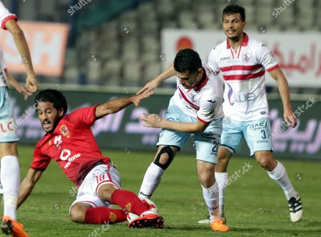 Al-Zamalek player Mahmoud Hamdy (C) fights for the ball with Al-Ahly players Marwan Mohsen  (L) during the Egyptian Premier League soccer match between Al-Zamalek and Al-Ahly at International Cairo Stadium in Cairo, Egypt, 26 April 2018.