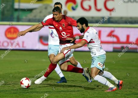 Al-Zamalek player Mahmoud Abdel Azez (R) fights for the ball with Al-Ahly players Saad Samir (L) during the Egyptian Premier League soccer match between Al-Zamalek and Al-Ahly at International Cairo Stadium in Cairo, Egypt, 26 April 2018.