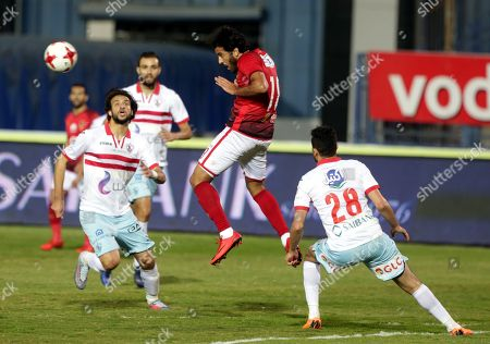 Al-Zamalek player Mahmoud Hamdy (R)  Mahmoud Alaa (L) fights for the ball with Al-Ahly players  Marwan Mohsen(C) during the Egyptian Premier League soccer match between Al-Zamalek and Al-Ahly at International Cairo Stadium in Cairo, Egypt, 26 April 2018.