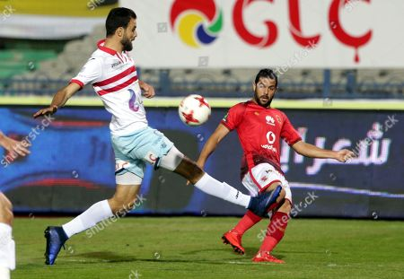 Al-Zamalek player Hamdi Nagguez (L) fights for the ball with Al-Ahly players  Sabri Raheel (R) during the Egyptian Premier League soccer match between Al-Zamalek and Al-Ahly at International Cairo Stadium in Cairo, Egypt, 26 April 2018.