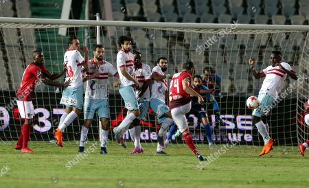 Al-Ahly player  Ahmed Fathy (C) takes a free kick during the Egyptian Premier League soccer match between Al-Zamalek and Al-Ahly at International Cairo Stadium in Cairo, Egypt, 26 April 2018.