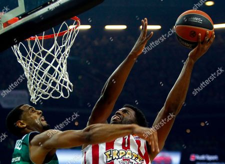 Stock Photo of Brandon Davis (L) of Zalgiris Kaunas and Jamel Mclean of Olympiacos Piraeus in action during the basketball Euroleague playoff match between Zalgiris Kaunas and Olympiacos Piraeus in Kaunas, Lithuania, 26 April 2018.