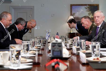 Jim Mattis, Avigdor Lieberman, Joseph Dunford. Defense Secretary Jim Mattis, right, next to Joint Chiefs Chairman Gen. Joseph Dunford, takes his seat for a meeting with the Israeli delegation, including Israeli Minister of Defense Avigdor Lieberman, far left, at the Pentagon
