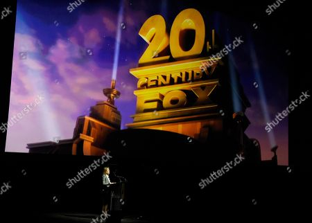 Stacey Snider, chairman and CEO of 20th Century Fox Film, addresses the audience underneath the company logo during the 20th Century Fox presentation at CinemaCon 2018, the official convention of the National Association of Theatre Owners, at Caesars Palace, in Las Vegas