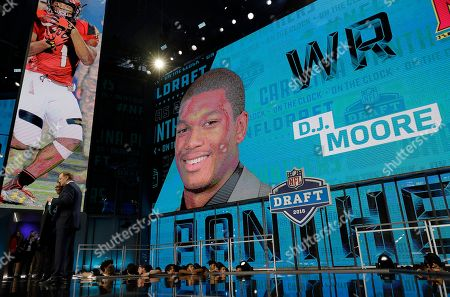 Commissioner Roger Goodell poses with a fan after the Carolina Panthers selected D.J. Moore during the first round of the NFL football draft, in Arlington, Texas