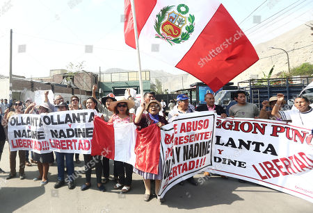 Supporters of former Peruvian President Ollanta Humala and his wife, Nadine Heredia, demonstrate on a street of Lima, Peru, 26 April 2018. The Constitutional Court (TC) of Peru accepted a request for 'habeas corpus' and revoked the preventive detention of former President Ollanta Humala (2011-2016) and his wife, Nadine Heredia, while they are being investigated for alleged money laundering.