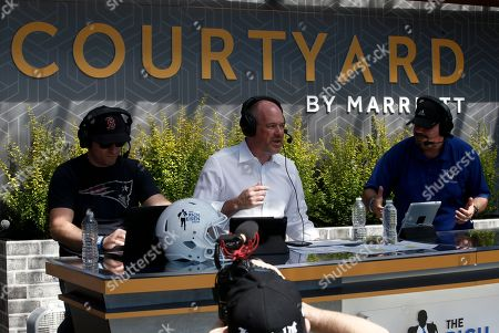 Host Rich Eisen, center, talks with co-host Chris Brockman, on left, and Mike Del Tufo as Courtyard, the Official Hotel of the NFL, welcomes fans to the 2018 NFL Draft with live viewing of the Rich Eisen Show in Dallas