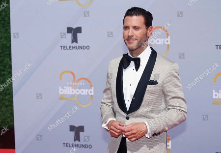 Quique Usales arrives at the Billboard Latin Music Awards at the Mandalay Bay Events Center, in Las Vegas
