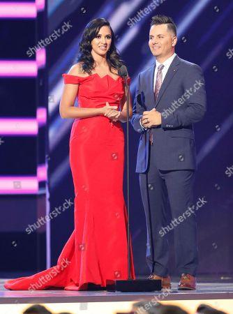 Ana Jurka, Karim Mendiburu. Ana Jurka, left, and Karim Mendiburu present the award for regional Mexican artist of the year, solo at the Billboard Latin Music Awards at the Mandalay Bay Events Center, in Las Vegas