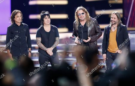Juan Calleros, Alex Gonzalez, Fher Olvera, Sergio Vallin. Juan Calleros, from left, Alex Gonzalez, Fher Olvera and Sergio Vallin, of Mana, accept the lifetime achievement award at the Billboard Latin Music Awards at the Mandalay Bay Events Center, in Las Vegas