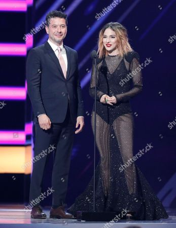 Raul Mendez, Paty Cantu. Raul Mendez, left, and Paty Cantu present the award for top Latin album of the year at the Billboard Latin Music Awards at the Mandalay Bay Events Center, in Las Vegas