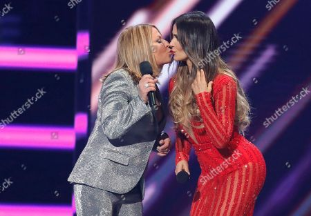 Ana Maria Polo, Catherine Siachoque. Ana Maria Polo, left, and Catherine Siachoque kiss as they present the award for Latin rhythm song of the year at the Billboard Latin Music Awards at the Mandalay Bay Events Center, in Las Vegas