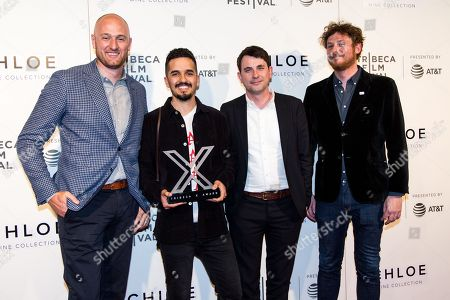 Stock Photo of Justin Lomax (L), director Mohammad Gorjestani (2-L), film producer Malcolm Pullinger (2-R) and Brian Braiker (R) pose for photos at the 2018 Tribeca Film Festival in New York, New York, USA, 26 April 2018.