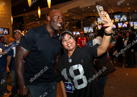 NFL Legend, Terrell Davis, snaps a selfie with an Oakland Raiders Season Ticket Member at Ticketmaster's official 2018 NFL Draft pre-party at AT&T Stadium, in Arlington, Texas
