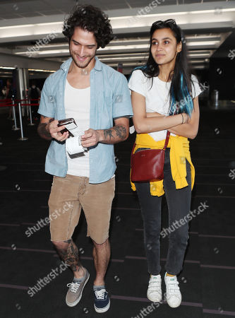 Stock Photo of Tyler Posey and Sophia Taylor Ali