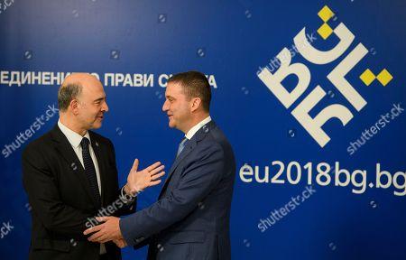 Stock Photo of Vladislav Goranov, European Economic and Financial Affairs Commissioner and Pierre Moscovici