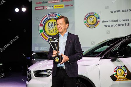 Volvo company president and CEO Hakan Samuelsson holding a Car of the year 2018 trophy which was awarded to Volvo XC40