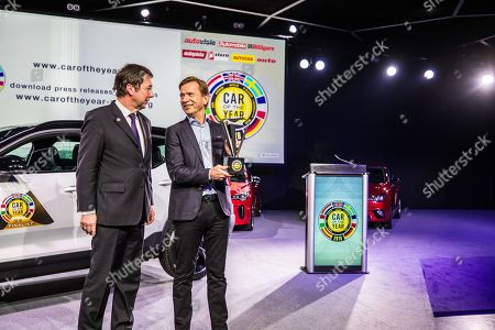 Jury president Frank Janssen and Volvo company president and CEO Hakan Samuelsson holding a Car of the year 2018 trophy  which was awarded to Volvo XC40