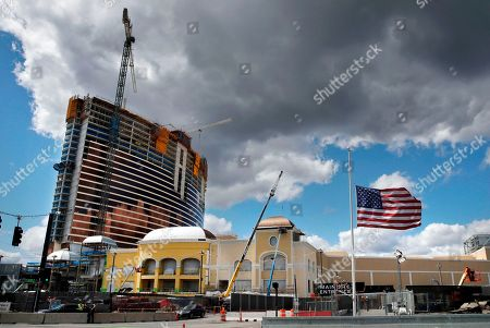 Clouds pass over the Wynn Resorts casino construction site in Everett, Mass., . Massachusetts gambling regulators consider Wynn Resorts' request to remove the name of company founder Steve Wynn, who faces numerous allegations of sexual misconduct, from its state casino license