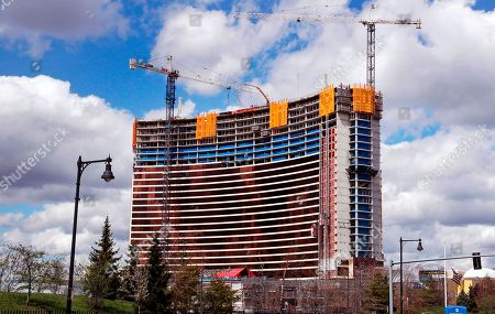 Construction cranes tower over the Wynn Resorts casino site in Everett, Mass., . Massachusetts gambling regulators consider Wynn Resorts' request to remove the name of company founder Steve Wynn, who faces numerous allegations of sexual misconduct, from its state casino license