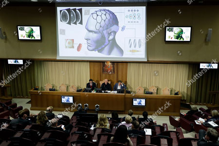 """Composer Peter Gabriel, center, delivers his speech at the """"United to Cure"""" international conference on the cure for cancer, at the Vatican"""