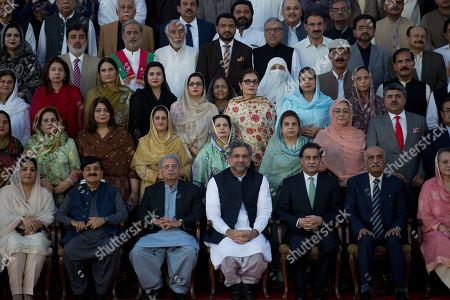 Pakistan's Prime Minister Shahid Khaqan Abbasi, fourth from left, in front row poses with outgoing parliamentarians after a budget session at the National Assembly in Islamabad, Pakistan, . Pakistan's finance minister has announced about 10 per cent increase in the country's defense spending in the annual budget ahead of this year's parliamentary elections