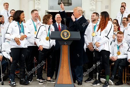Donald Trump, Redmond Gerard. President Donald Trump jokes with Olympic snowboarding gold medalist Redmond Gerard during an event with the United States Olympic and Paralympic Teams at the White House, in Washington