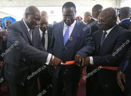 Ivorian Vice President Daniel Kablan Duncan cuts a ribbons during the opening ceremony of the 8th edition of the Abidjan International Tourism Fair (Sita), Abidjan, Ivory Coast, 27 April 2018. The International Tourism Fair of Abidjan (SITA), which is held every year in April to May, is an important meeting platform that allows participants to promote their destinations and understand market developments. This is why the Ivorian government aims through SITA to attract investors and position tourism as a strategic economic activity sector in the development of Cote d'Ivoire. This show highlights three important aspects of the tourism industry, namely eco-tourism, cultural tourism and event tourism.