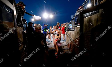 Jenny Simpson waves to fans as she leaves the track after winning the women's special 2-mile run at the Drake Relays athletics meet, in Des Moines, Iowa