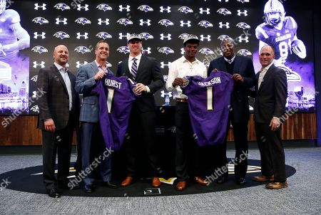 Joe Hortiz, Hayden Hurst, Lamar Jackson, John Harbaugh, Ozzie Newsome, Eric DeCosta. The Baltimore Ravens' first round draft picks, tight end Hayden Hurst, third from left, and quarterback Lamar Jackson, third from right, pose with Ravens director of college scouting Joe Hortiz, from left, head coach John Harbaugh, general manager Ozzie Newsome and assistant general manager Eric DeCosta during an NFL football news conference at the team's headquarters in Owings Mills, Md