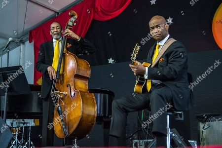Ron Carter, Russell Malone. Ron Carter, left, and Russell Malone of the Ron Carter Trio performs at the New Orleans Jazz and Heritage Festival, in New Orleans