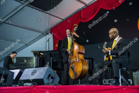 Donald Vega, Ron Carter, Russell Malone. Donald Vega, from left, Ron Carter and Russell Malone of the Ron Carter Trio perform at the New Orleans Jazz and Heritage Festival, in New Orleans