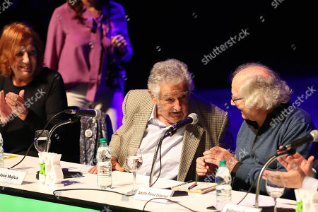 Former Uruguayan Presidenr Jose Mujica (C) chats with Argentinian Peace Nobel Laureate Adolfo Perez Esquivel (R) during the conference 'The bright legacy of memory' as part of the international encounter 'Voy x La Paz' (I go for peace) in Montevideo, Uruguay, 27 April 2018. Nobel Laureates Guatemalan Rigoberta Menchu, Iranian Shirin Ebadi, Argentinian Adolfo Perez Esquivel and Polish Lech Walesa, are guests to the event.