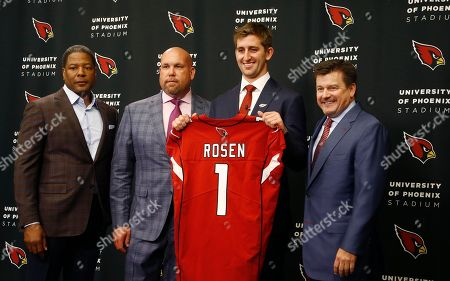 The Arizona Cardinals introduce their first-round NFL football draft pick Josh Rosen, second from right, as he poses for a photograph with head coach Steve Wilks, left, general manager Steve Keim, second from left, and team president Michael Bidwill, right, in Tempe, Ariz