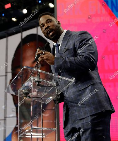 Former New York Giants player Justin Tuck announces UTEP's Will Hernandez as the team's selection during the second round of the NFL football draft, in Arlington, Texas