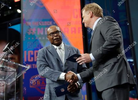 Mike Singletary, Roger Goodell. Prof Football Hall of Famer Mike Singletary, left, greets NFL Commissioner Roger Goodell as Singletary announces the Chicago Bears' pick during the second round of the NFL football draft, in Arlington, Texas. The Bears selected Iowa's James Daniels