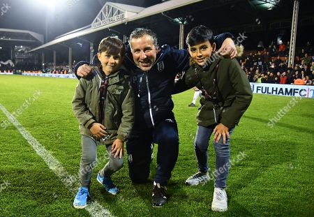 Fulham assistant manager Javier Pereira with his nephews during the lap of honour