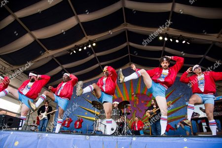 Sturgill Simpson, left, performs with the 610 Stompers at the New Orleans Jazz and Heritage Festival, in New Orleans