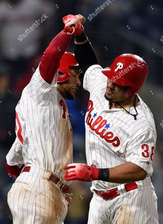 Philadelphia Phillies' Jorge Alfaro, right, celebrates with J.P. Crawford after Alfaro hit a two-run home run off Atlanta Braves' Chase Whitley during the seventh inning of a baseball game, in Philadelphia