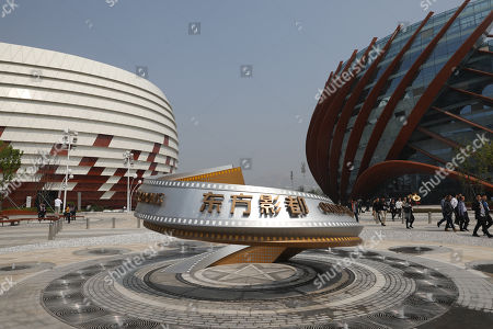 A view of buildings part of the Wanda Oriental Movie Metropolis in Qingdao, Shandong province, China, 28 April 2018. Wanda Qingdao Oriental Movie Metropolis opens on 28 April 2018 which is a major Chinese studio, combining film and television production and several other facilities which was funded by Wang Jianlin, CEO of the Dalian Wanda Group. Starting construction on 22 September 2013 with the total investment of 50 billion RMB yuan (around 6.5 billion Euros), it has the world's largest studio pavilion of 10,000 square meters, featuring some of the world's largest and most technologically-advanced facilities.