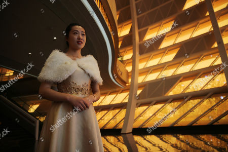 A Chinese guide stands before the opening ceremony of Wanda Oriental Movie Metropolis in Qingdao, Shandong province, China, 28 April 2018. Wanda Qingdao Oriental Movie Metropolis opens on 28 April 2018 which is a major Chinese studio, combining film and television production and several other facilities which was funded by Wang Jianlin, CEO of the Dalian Wanda Group. Starting construction on 22 September 2013 with the total investment of 50 billion RMB yuan (around 6.5 billion Euros), it has the world's largest studio pavilion of 10,000 square meters, featuring some of the world's largest and most technologically-advanced facilities.