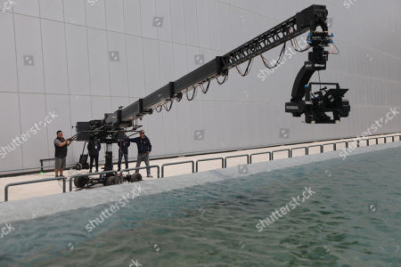 A camera crane rig is seen recording footage over a large water pool at Wanda Film Industrial Park of Wanda Oriental Movie Metropolis in Qingdao, Shandong province, China, 28 April 2018. Wanda Qingdao Oriental Movie Metropolis opens on 28 April 2018 which is a major Chinese studio, combining film and television production and several other facilities which was funded by Wang Jianlin, CEO of the Dalian Wanda Group. Starting construction on 22 September 2013 with the total investment of 50 billion RMB yuan (around 6.5 billion Euros), it has the world's largest studio pavilion of 10,000 square meters, featuring some of the world's largest and most technologically-advanced facilities.