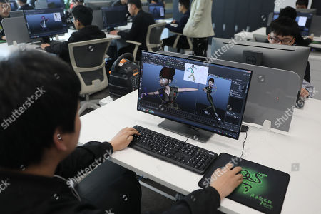 Stock Photo of A film crew member works with Computer-generated imagery (CGI) on a computer at the Maker Space at Wanda Film Industrial Park of Wanda Oriental Movie Metropolis in Qingdao, Shandong province, China, 28 April 2018. Wanda Qingdao Oriental Movie Metropolis opens on 28 April, a major Chinese studio, combining film and television production and several other facilities, funded by Wang Jianlin, CEO of the Dalian Wanda Group. The construction of the facility started on 22 September 2013, with the total investment of 50 billion RMB yuan (around 6.5 billion Euros), it has the world's largest studio pavilion of 10,000 square meters, featuring some of the world's largest and most technologically-advanced facilities.
