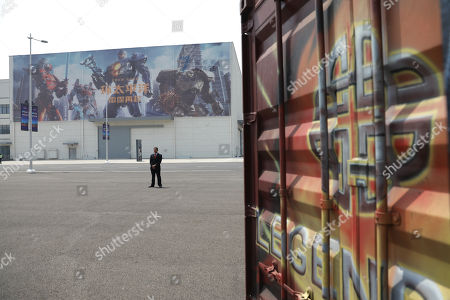 A security guard stands in front of film studio pavilions at Wanda Film Industrial Park of Wanda Oriental Movie Metropolis in Qingdao, Shandong province, China, 28 April 2018. Wanda Qingdao Oriental Movie Metropolis opens on 28 April, a major Chinese studio, combining film and television production and several other facilities, funded by Wang Jianlin, CEO of the Dalian Wanda Group. The construction of the facility started on 22 September 2013, with the total investment of 50 billion RMB yuan (around 6.5 billion Euros), it has the world's largest studio pavilion of 10,000 square meters, featuring some of the world's largest and most technologically-advanced facilities.
