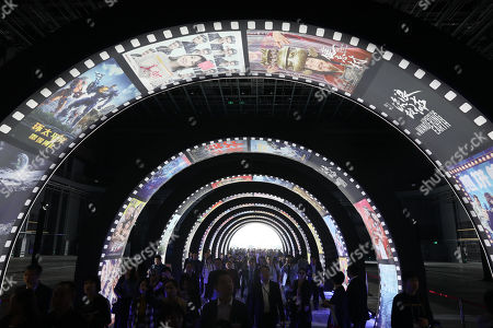 People visit a 10,000-square-meter film studio pavilion of Wanda Oriental Movie Metropolis in Qingdao, Shandong province, China, 28 April 2018. Wanda Qingdao Oriental Movie Metropolis opens on 28 April, a major Chinese studio, combining film and television production and several other facilities, funded by Wang Jianlin, CEO of the Dalian Wanda Group. The construction of the facility started on 22 September 2013, with the total investment of 50 billion RMB yuan (around 6.5 billion Euros), it has the world's largest studio pavilion of 10,000 square meters, featuring some of the world's largest and most technologically-advanced facilities.
