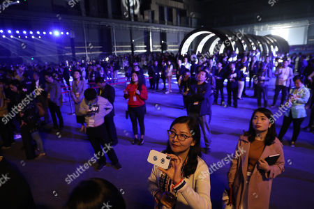 Visitors visit a 10,000-square-meter film studio pavilion of Wanda Oriental Movie Metropolis in Qingdao, Shandong province, China, 28 April 2018. Wanda Qingdao Oriental Movie Metropolis opens on 28 April, a major Chinese studio, combining film and television production and several other facilities, funded by Wang Jianlin, CEO of the Dalian Wanda Group. The construction of the facility started on 22 September 2013, with the total investment of 50 billion RMB yuan (around 6.5 billion Euros), it has the world's largest studio pavilion of 10,000 square meters, featuring some of the world's largest and most technologically-advanced facilities.